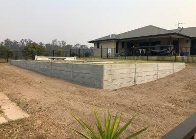 Concrete Sleeper Retaining Walls - Blue Sky Yards